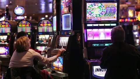 PACIFIC OCEAN, ALASKA MAY 2013: Tourist returns to cruise vacation after economic and accident problems. Gambling main adult entertainment anf profit generation for industry. Unidentifiable people.