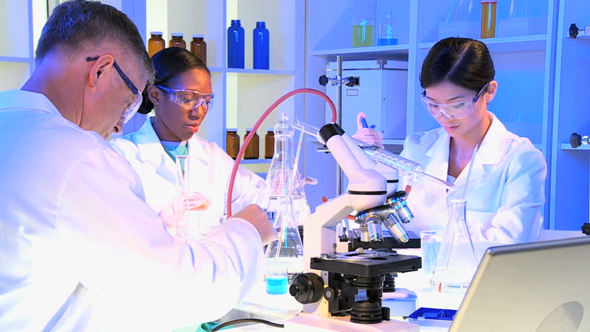 Male Female Laboratory Assistants In Protective Glasses Checking ...