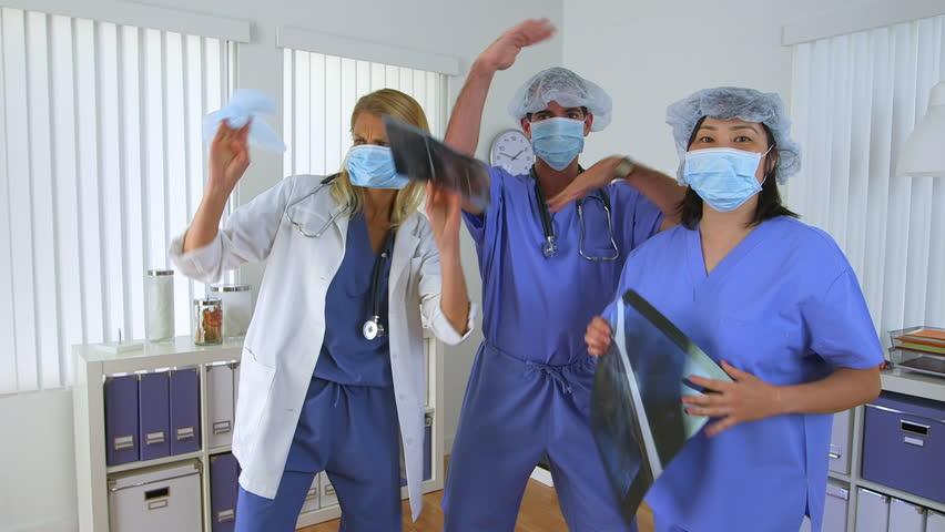 Doctors dancing in the office