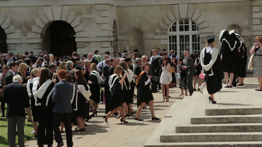 CAMBRIDGE, CAMBRIDGESHIRE/ENGLAND - JUN 29: Unidentified university graduates and guests at congregation, Senate House on Jun 29, 2013 in Cambridge. Senate House is used for degree ceremonies.