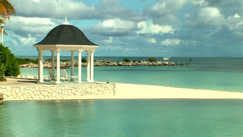 Island of the Bahamas and Caribbean with its beautiful beaches , blue water, sand as fine as sugar, and palm trees blowing in the warm trade winds.