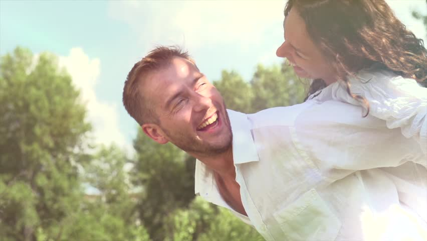 Happy Couple Having Fun Outdoors. Laughing Joyful Family. Freedom Concept. | Shutterstock HD Video #4285643