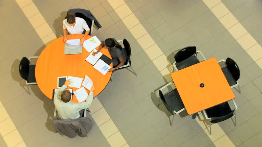 Overhead view of groups of multi ethnic business people with clients holding meetings | Shutterstock HD Video #4286429