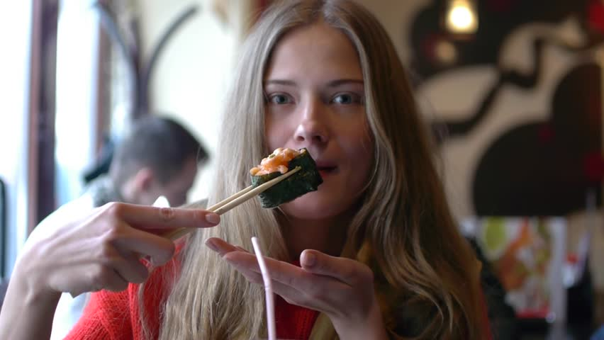 HD1080p25 Sexy woman eating sushi in restaurant and enjoying.