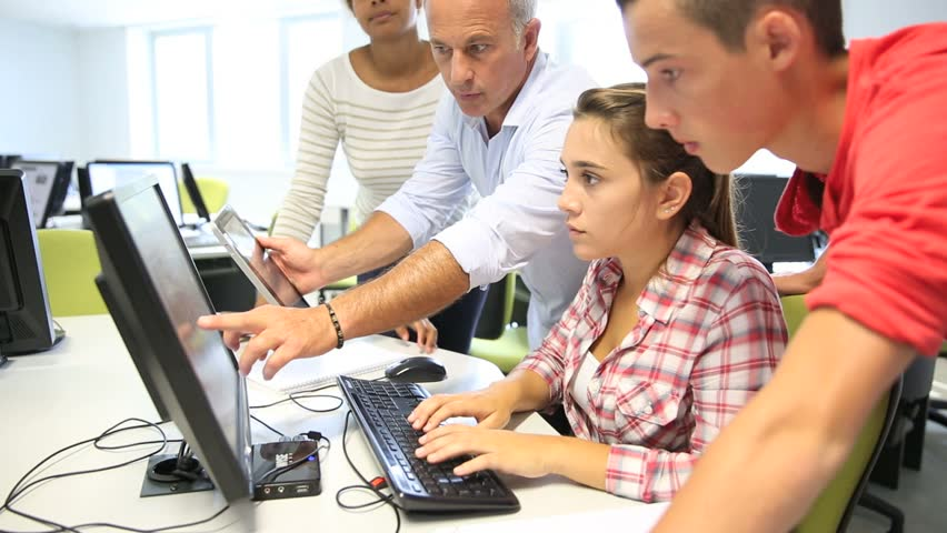 Teacher with students in computing class | Shutterstock HD Video #4326821