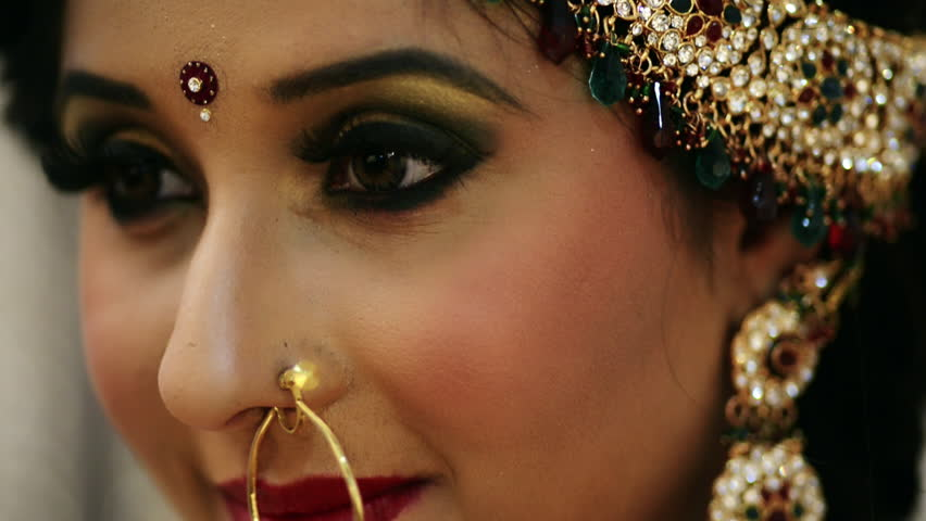 shot of a happy indian bride wearing a nose ring stock