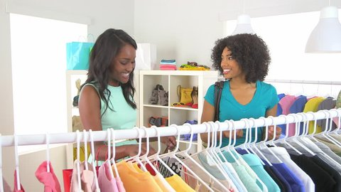 African American friends shopping together and buying underwear