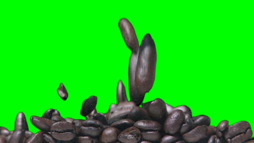 Coffee beans filling up the screen against a green background.  Recorded with