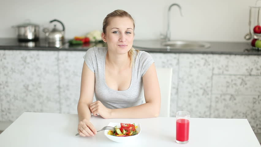 Image result for woman eating at dinner table