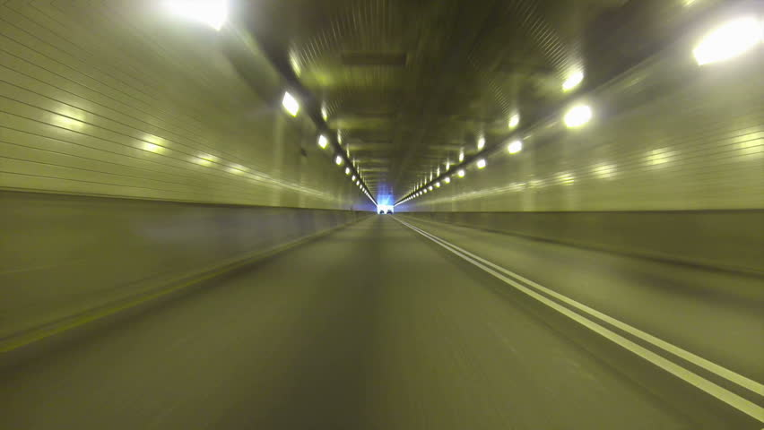 Low-angle perspective of exiting the Fort Pitt Tunnels in Pittsburgh, Pennsylvania.