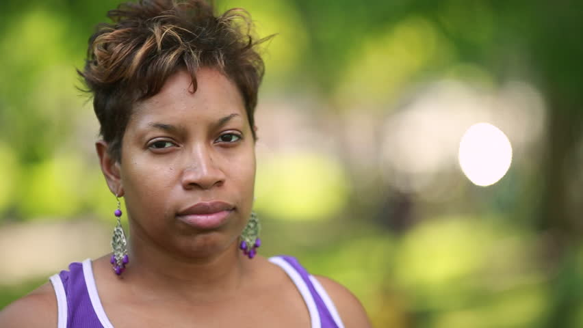 Black African-American woman serious concerned sad worried face