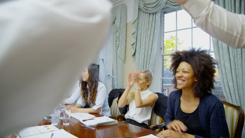 Successful professional team clapping to celebrate their own success   Shutterstock HD Video #4391534