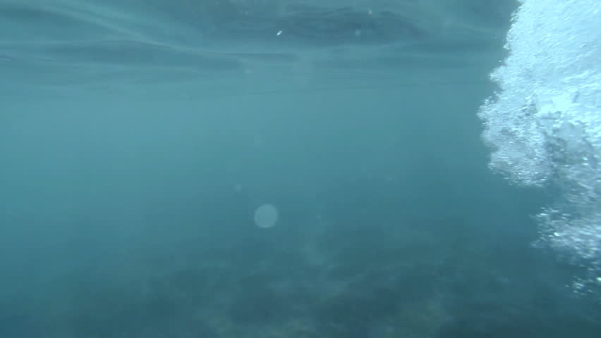 Bubbles under water. Bubbles rising to the surface. Slow motion.