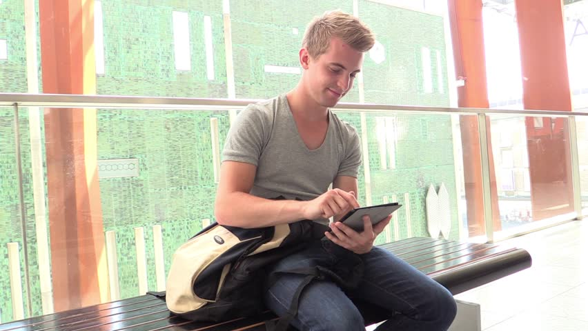 Young attractive man working on iPad