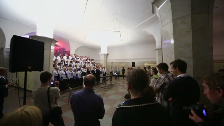 MOSCOW - MAY 19: People watch concert of Academic big chorus of RSUH at metro stations Kropotkinskaya as part of Museum Night, on 19 May 2012 in Moscow, Russia. | Shutterstock HD Video #4421861