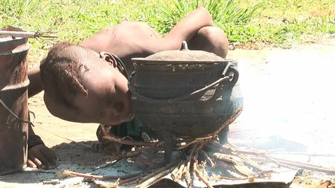 KAMANJAB - MARCH 28: African native tribes - Young Himba boy makes fire on March 28, 2012 in Kamanjab, Namibia.