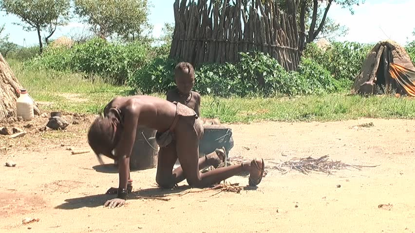 KAMANJAB - MARCH 28:  African native tribes - Young Himba boy makes fire  on March 28, 2011 in Kamanjab, Namibia.