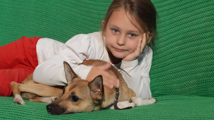 little girl and red puppy