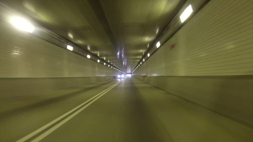 A rear view perspective of driving into the Fort Pitt Tunnel in Pittsburgh, Pennsylvania.