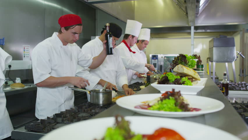 Restaurant Kitchen Video group of chefs giving plates on order line in a restaurant kitchen