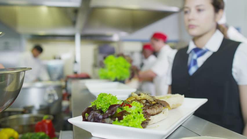 Restaurant Kitchen Video motion chefs of a restaurant kitchen stock footage video 5285243