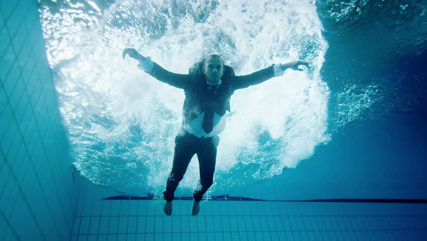 Drowning underwater businessman, falls into the water and remains motionless and unable to help himself. | Shutterstock HD Video #4459547