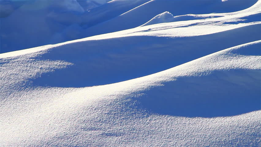 Snowy forms of winter backlit by sunlight, panning shot, closeup | Shutterstock HD Video #4469216