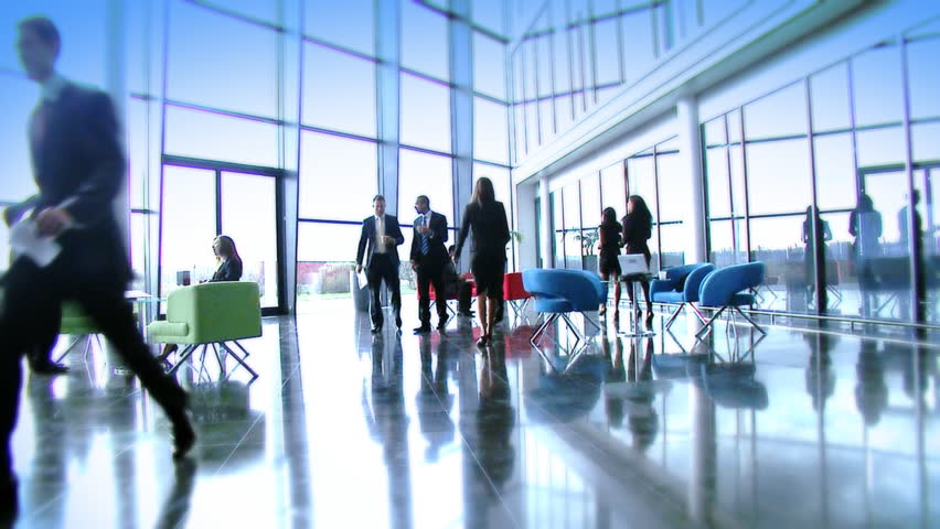 Large multi ethnic business group in relaxed meeting area of a large contemporary corporate building. High quality HD video footage | Shutterstock HD Video #4479578
