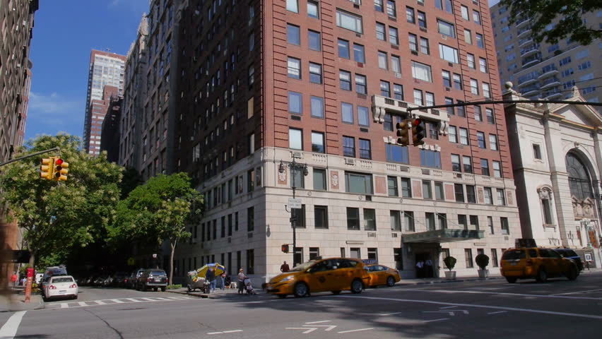 A typical daytime New York City apartment building establishing shot.
