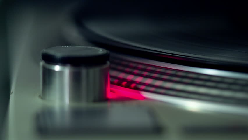 close up shot of the lights on a dj record player