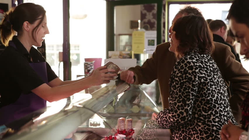 Delicatessen customers shopping. A relaxed cafe shop where people are buying fresh food. | Shutterstock HD Video #4484813