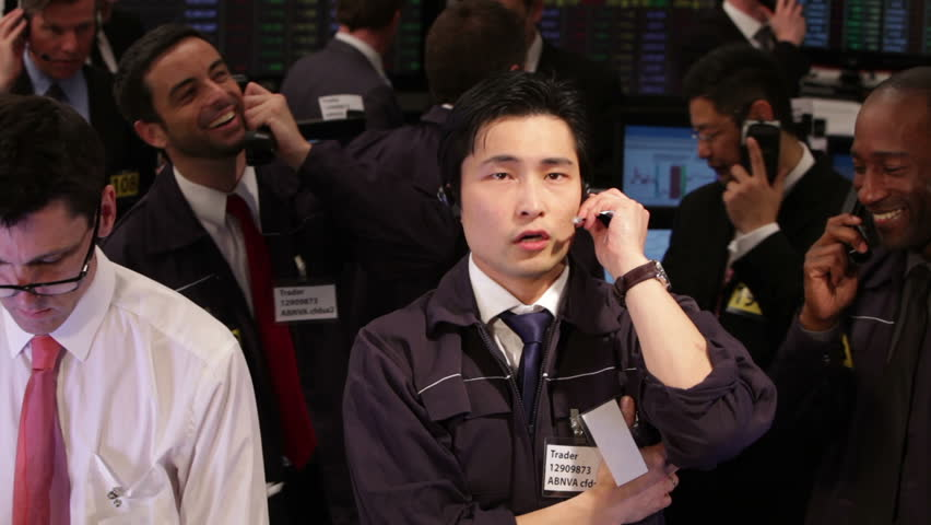 Crowd of financial traders in a Stock Exchange. Business people trading stocks and shares on an international scale. Trading currency, stocks and bonds.   Shutterstock HD Video #4485263