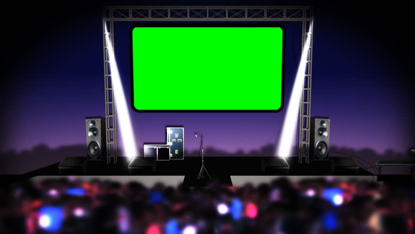 The crowd dances in front of a concert nightclub stage as light beams move. There is a green screen above the stage ready for compositing. | Shutterstock HD Video #448969