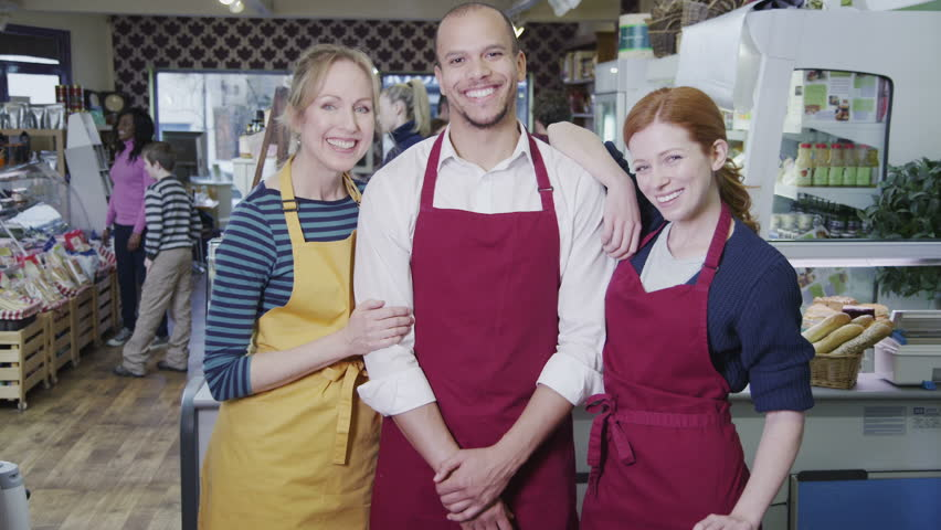 Portrait of happy male and female workers in a cafe or grocery store. | Shutterstock HD Video #4501883