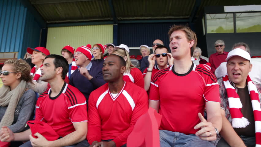 Enthusiastic crowd of spectators watching a sports game or football match and reacting    Shutterstock HD Video #4536263