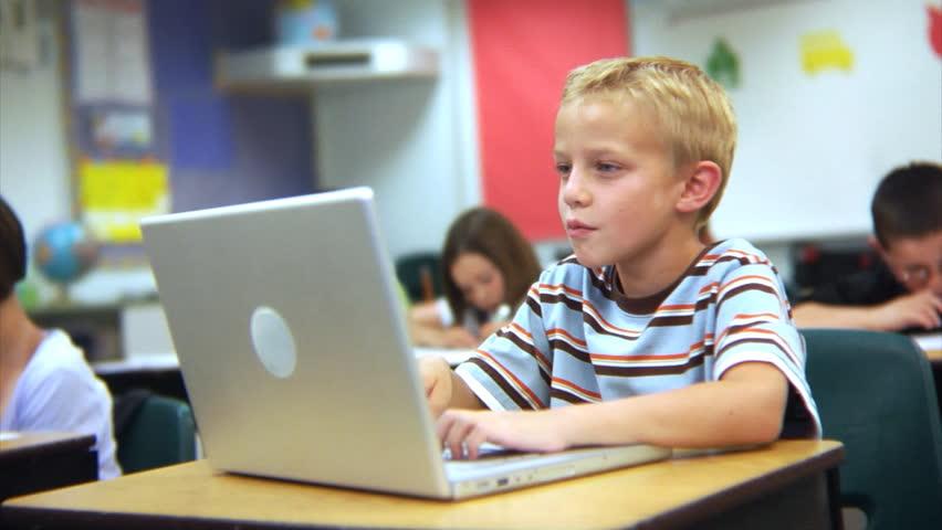 School student working on laptop computer | Shutterstock HD Video #4541222