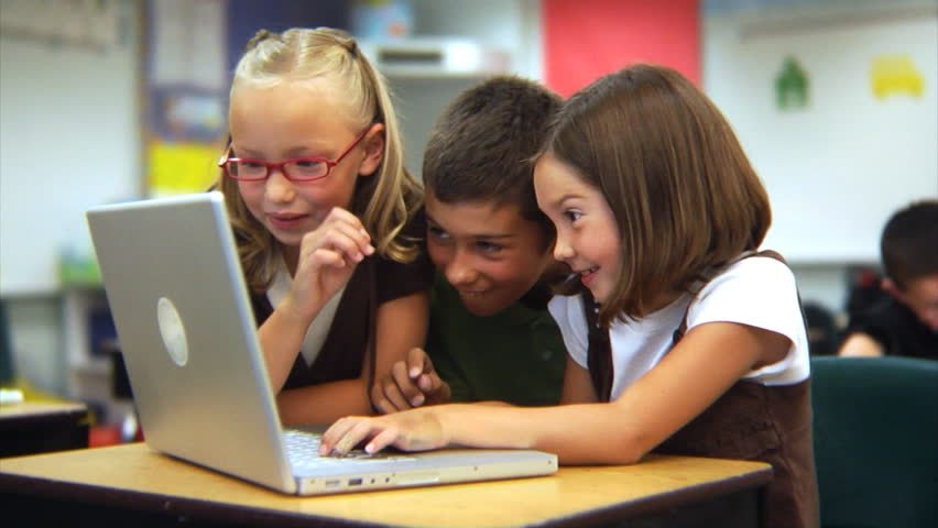 Elementary school students looking at laptop computer | Shutterstock HD Video #4542863