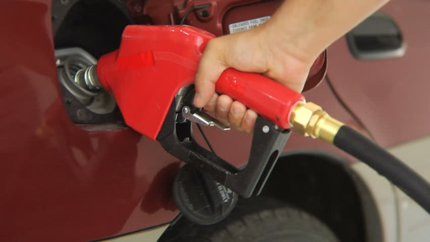 Filling car with gas, close up