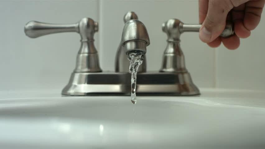 A Macro Of Running Water From Bathroom Faucet Spout. Starts From ...