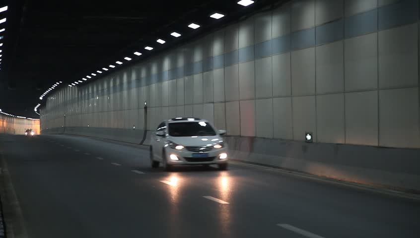 Animation Of Yellow Race Car Racing On Road In Underground Tunnel