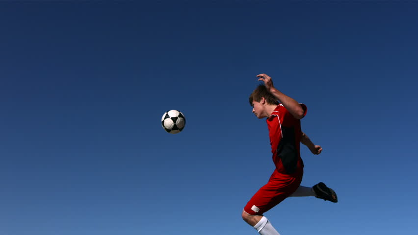 Soccer player kicking ball in mid-air, slow motion | Shutterstock HD Video #4578347