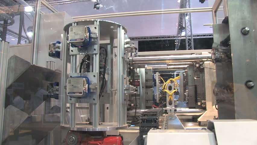 Automated machinery from a factory making containers  | Shutterstock HD Video #459859