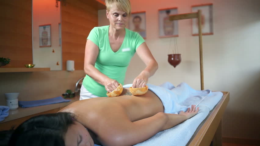 Female Therapist Doing Special Massage To Woman With Tattoo
