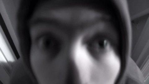 Creepy, possessed man in the basement attacks camera.