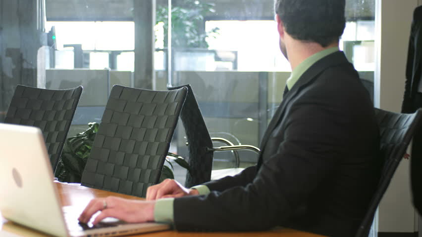 Two young business professionals meet up in a conference room. Medium shot | Shutterstock HD Video #4632803