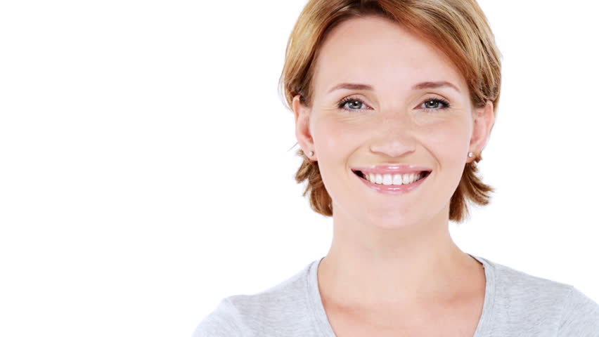 Front  portrait of the beautiful  smiling woman looking at camera over white background. Full hd video clip 1920x1080