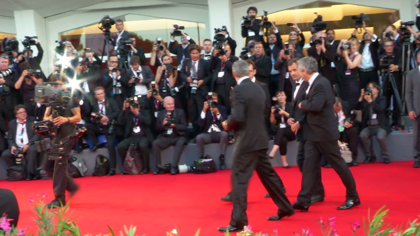 """VENICE - AUGUST 28: George Clooney, Sandra Bullock and Alfonso Cuarón on the red carpet for the movie """"Gravity"""" during the 70th International Venice Film Festival on August 28, 2013 in Venice."""