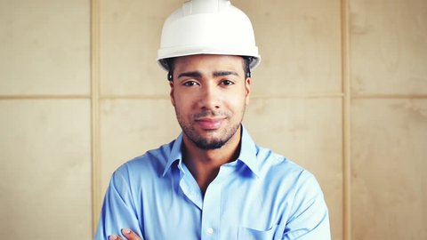 Happy foreman with arms folded at building site inspection