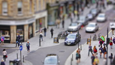 """BATH, UK - SEPT 10: Time lapse of activity on Milsom Street, Bath on 10th Sept 2013 with a tilt shift effect. The street is a busy shopping hub and was named """"Britain's Best Fashion Street"""" in 2010."""