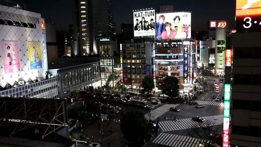 Japan - March 2011: Nighttime iew of billboard advertisements and automobile traffic at the busiest